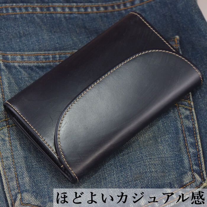 ホワイトハウスコックスS7660三つ折り財布とジーンズの写真